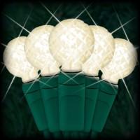 "LED warm white Christmas lights 50 G12 mini globe LED bulbs 4"" spacing, 17ft. green wire, 120VAC"